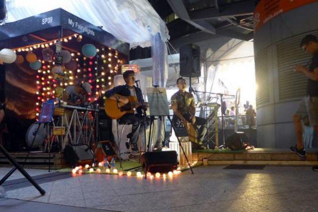 DAYA TARIKAN: Gerai My Fairylights menyediakan ruang persembahan muzik di Bazaar MegaExpress bagi menarik minat pengunjung - Foto ihsan AHMAD JIHADI SAHRAN