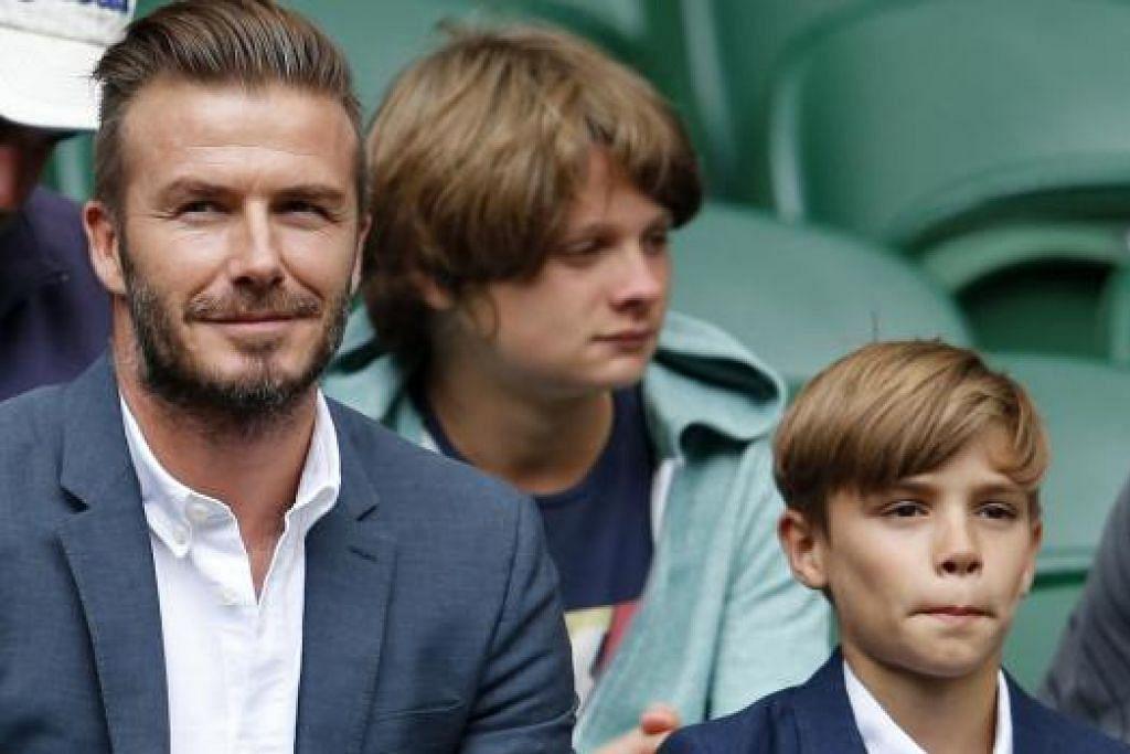 RANCANGAN KIAN JADI REALITI: Legenda bola sepak England, David Beckham, yang kumpulan pelaburnya rancang sebuah kelab bola sepak di Maimi, menyaksikan kejohanan tenis Wimbledon bersama anaknya, Romeo, baru-baru ini. - REUTERS