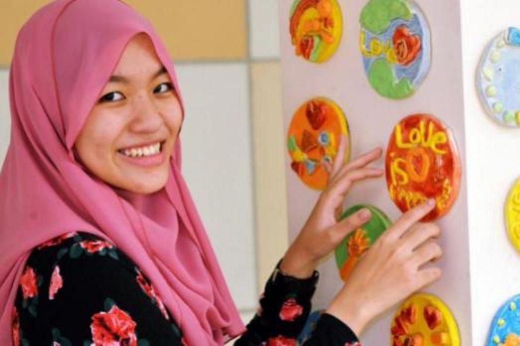 KERJAYA IDAMAN: Cik Syafinah Ibrahim berharap dapat menjalin hubungan baik dengan pelajarnya. - Foto KHALID BABA