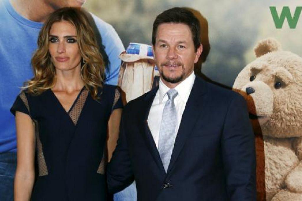 SUAMI DAN AYAH PENYAYANG: Mark Wahlberg dan isterinya, Rhea Durham, hidup bahagia dengan empat anak mereka. - Foto fail