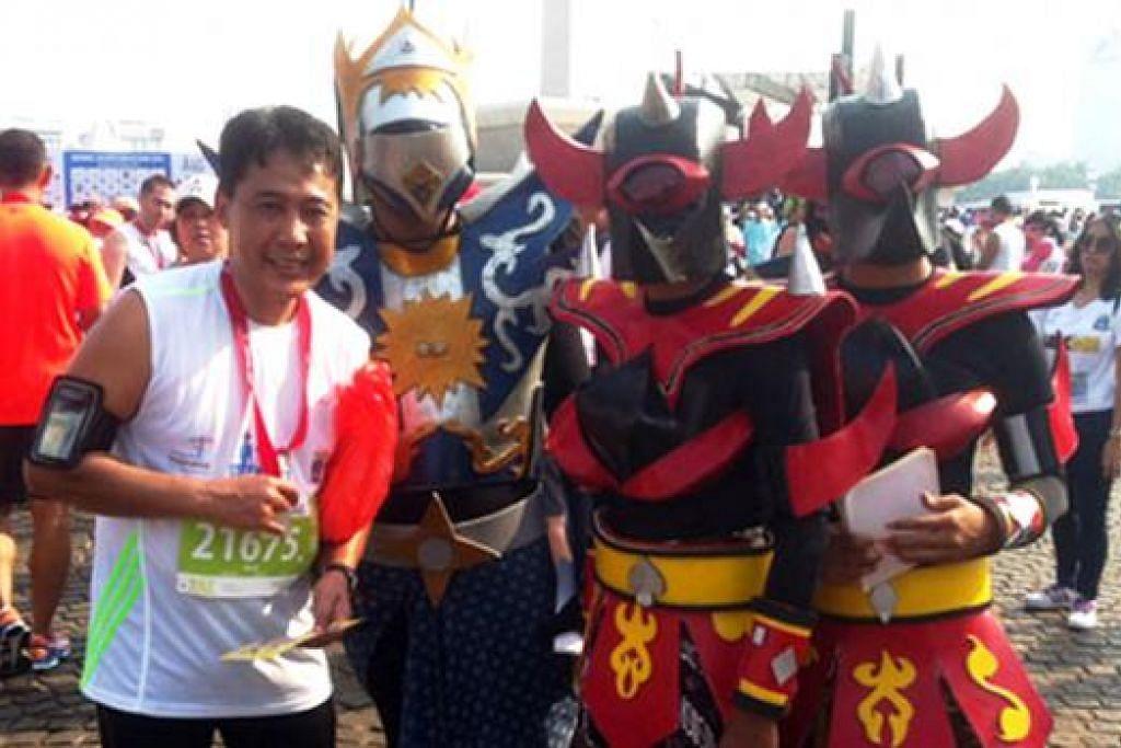 ANEKA RAGAM: Suasana meriah menyelubungi 'Festival City Marathon' di Tugu Monas, Jakarta.