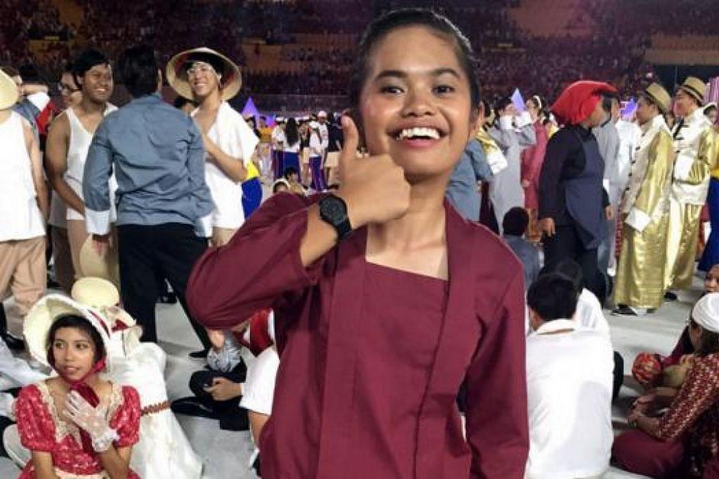PERNAH MAHU 'GIVE UP': Cik Shariffah Nadia gembira mendapat sokongan daripada ibu bapanya hingga beliau mampu menjalani latihan NDP dengan baik walaupun berpuasa. - Foto ihsan SHARIFFAH NADIA SAID MOHAMED ISHAM