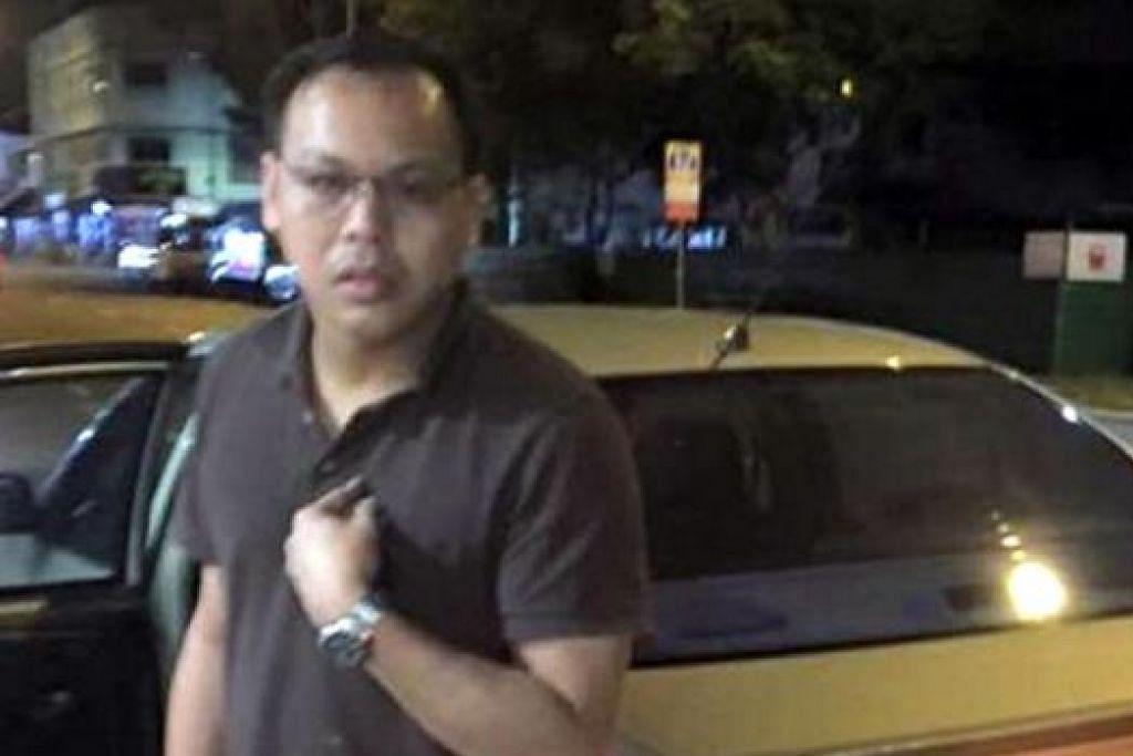 PEMANDU YANG TERLIBAT: Encik Tong telah dipecat selepas dituduh mencaci dan memaksa seorang penumpang turun daripada kenderaannya pada Rabu 29 Julai apabila beliau gagal mengesahkan kod promosi SG50 yang cuba digunakan. - Foto ADELINE A. LOK