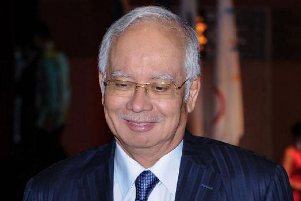 DATUK SERI NAJIB TUN RAZAK: Menyatakan bahawa kerajaan Malaysia tidak boleh menghalang kemajuan teknologi namun tidak boleh memberikan kebebasan mutlak hingga perkara yang tidak benar menjadi benar. - Foto AFP
