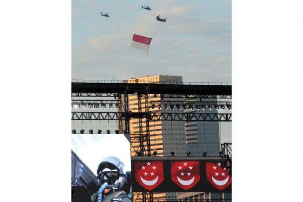 BENDERA DI ANGKASA: Mengikut tradisi bertahun lamanya, bendera Singapura dilayangkan semasa bahagian Penghormatan Terbang Lalu di NDP semalam.