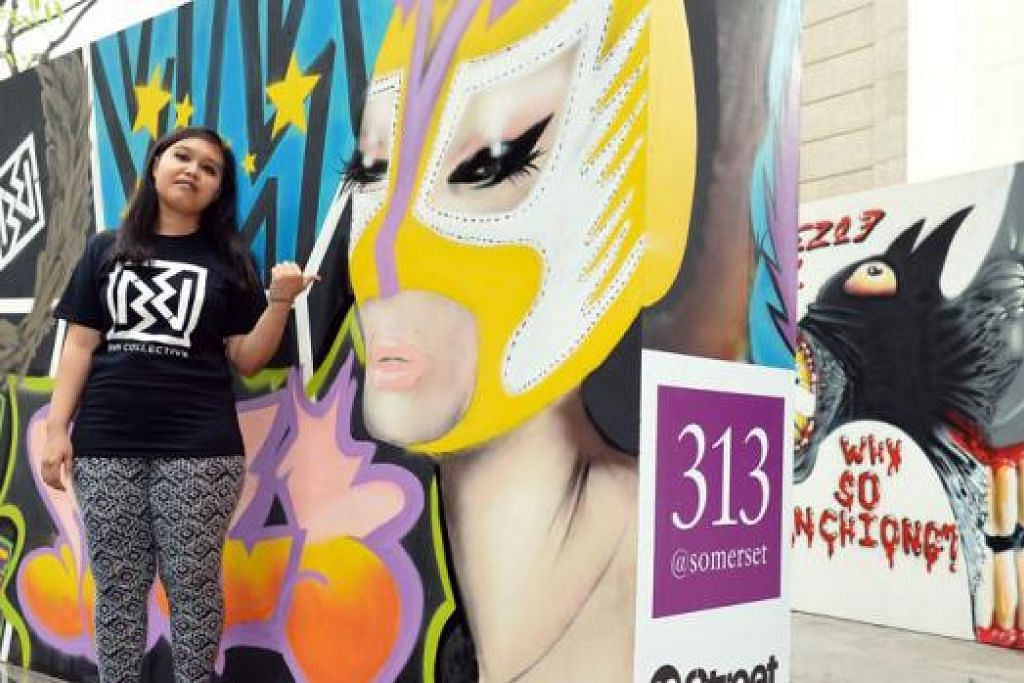 MINAT DARI KECIL: Cik Nurhaziqah Abdul Halim atau Miz-E sudah mula melakar dan menyembur grafiti sejak kecil dan seronok mewarnai sekitaran dengan hasil ilhamnya.- Foto M.O. SALLEH