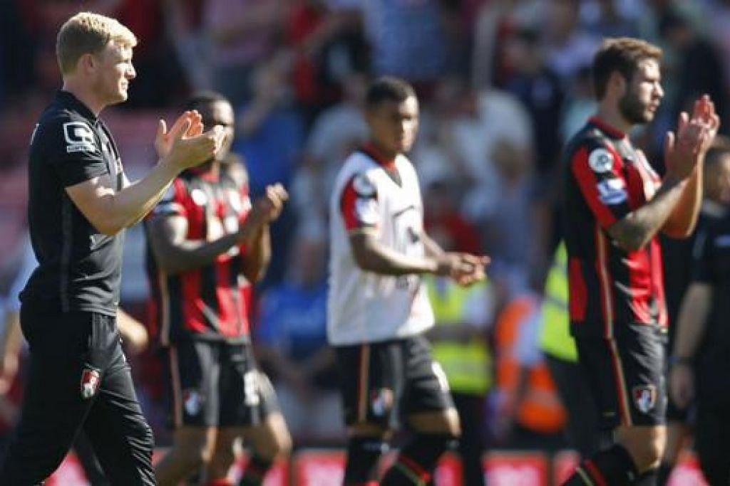 TIDAK KALAH SEMANGAT: Pengurus Bournemouth, Eddie Howe (kiri), menepuk kanan sebagai mengiktiraf sumbangan para pemainnya yang berjuang hebat sebelum tewas 0-1 kepada Aston Villa dalam perlawanan pembukaannya minggu lalu. - Foto REUTERS