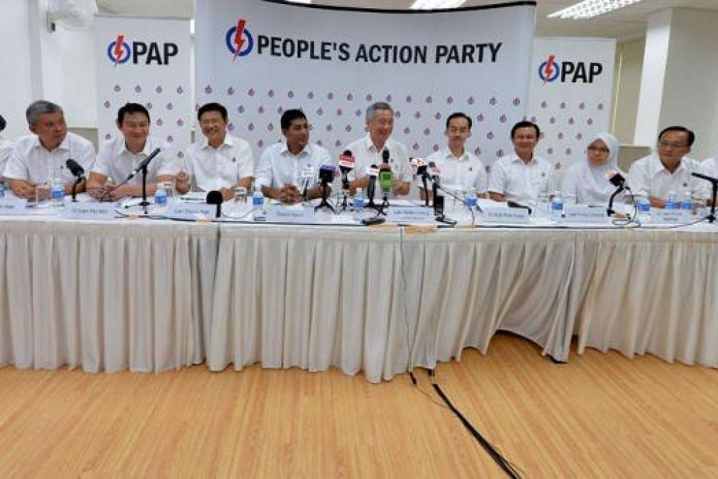 BERKHIDMAT UNTUK MASYARAKAT: (Dari kiri) Encik Inderjit Singh (akan bersara), Encik Ang Hin Kee (calon GRC Ang Mo Kio), Dr Lam Pin Min (calon SMC Sengkang West), Encik Gan Thiam Poh (calon GRC Ang Mo Kio), Encik Darryl David (calon GRC Ang Mo Kio), Perdana Menteri Encik Lee Hsien Loong (ketua GRC Ang Mo Kio), Dr Koh Poh Koon (calon GRC Ang Mo Kio), Encik Lee Hong Chuang (calon SMC Hougang), Dr Intan Azura Mokhtar (calon GRC Ang Mo Kio), Encik Seng Han Thong (akan bersara) dan Encik Yeo Guat Kwang (akan dipindahkan ke kawasan undi lain). – Foto M. O. SALLEH