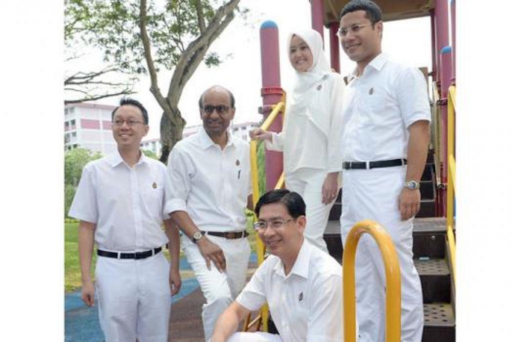 SEDIA BERKHIDMAT: Pasukan PAP bagi GRC Jurong, (berdiri dari kiri) Dr Tan Wu Meng, Encik Tharman Shanmugaratnam, Cik Rahayu Mahzam, Encik Desmond Lee dan Encik Ang Wei Neng (duduk). - Foto TAUFIK A. KADER