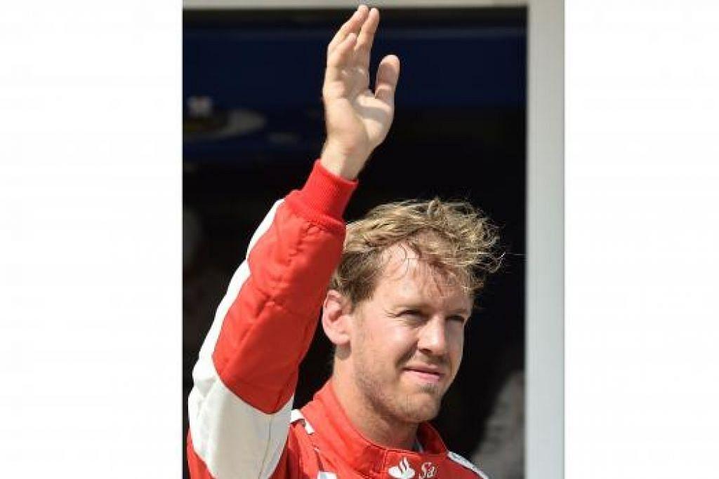 MELAMBAI SEBELUM PERLUMBAAN: Pemandu Ferrari Jerman, Sebastian Vettel, di sesi kelayakan di gelanggang Hungaroring dekat Budapest, Hungary, baru-baru ini sebelum permulaan Grand Prix Formula Satu Hungary.