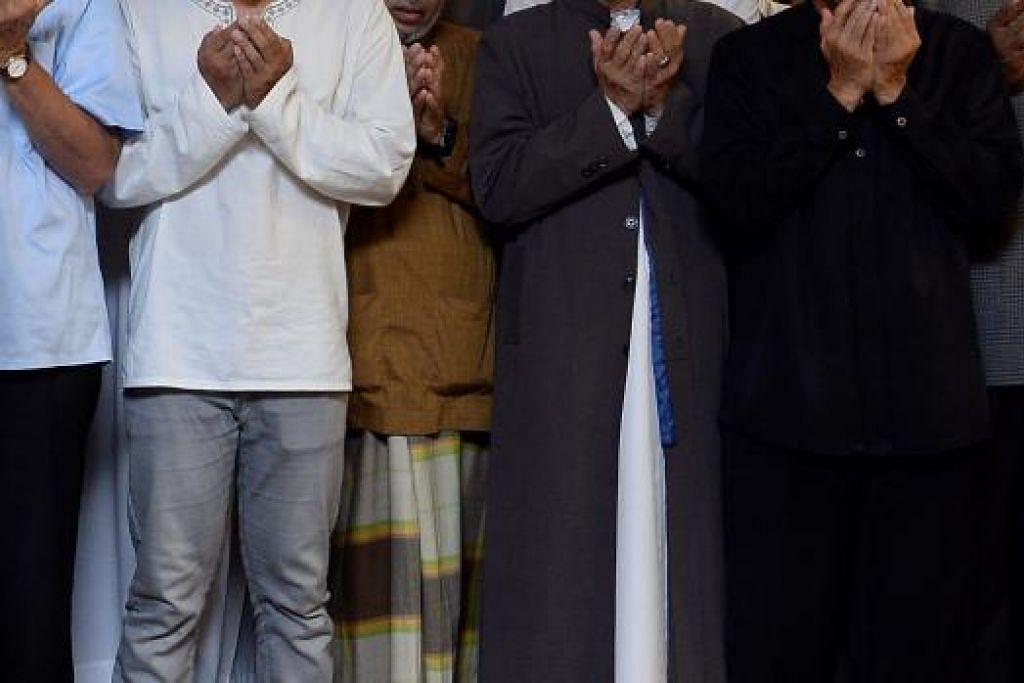SOLAT TETAP SAH: Tidak kira Muslim itu mengenakan seluar, kain atau jubah, solatnya tetap sah selagi auratnya tidak terdedah. - Foto fail