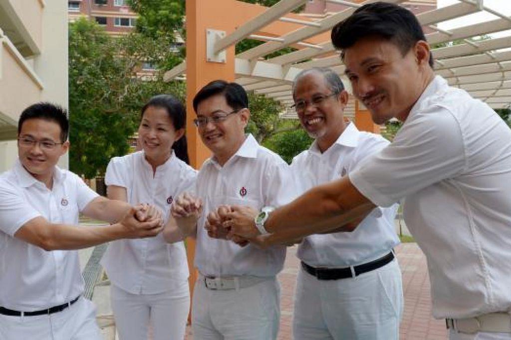 TEGUHKAN SEMANGAT: Dari kiri, Encik Choo, Cik Cheng, Encik Heng, Encik Masagos dan Encik Baey yang akan bertanding di GRC Tampines. – Foto TUKIMAN WARJI