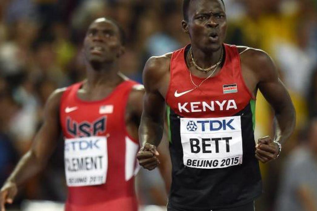REAKSI SANG JUARA: Pelari Kenya, Nicholas Bett (kanan), melahirkan kegembiraan memenangi perlumbaan 400 meter berpagar di Kejohanan Atletik Dunia yang berlangsung di Stadium Sarang Burung, Beijing, semalam.