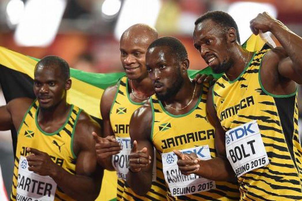 HEBAT: Gandingan 4x100 meter Jamaica (dari kiri), Nesta Carter, Asafa Powell, Nickel Ashmeade dan Usain Bolt memenangi emas acara itu, meneruskan monopoli mereka dalam perlumbaan itu.