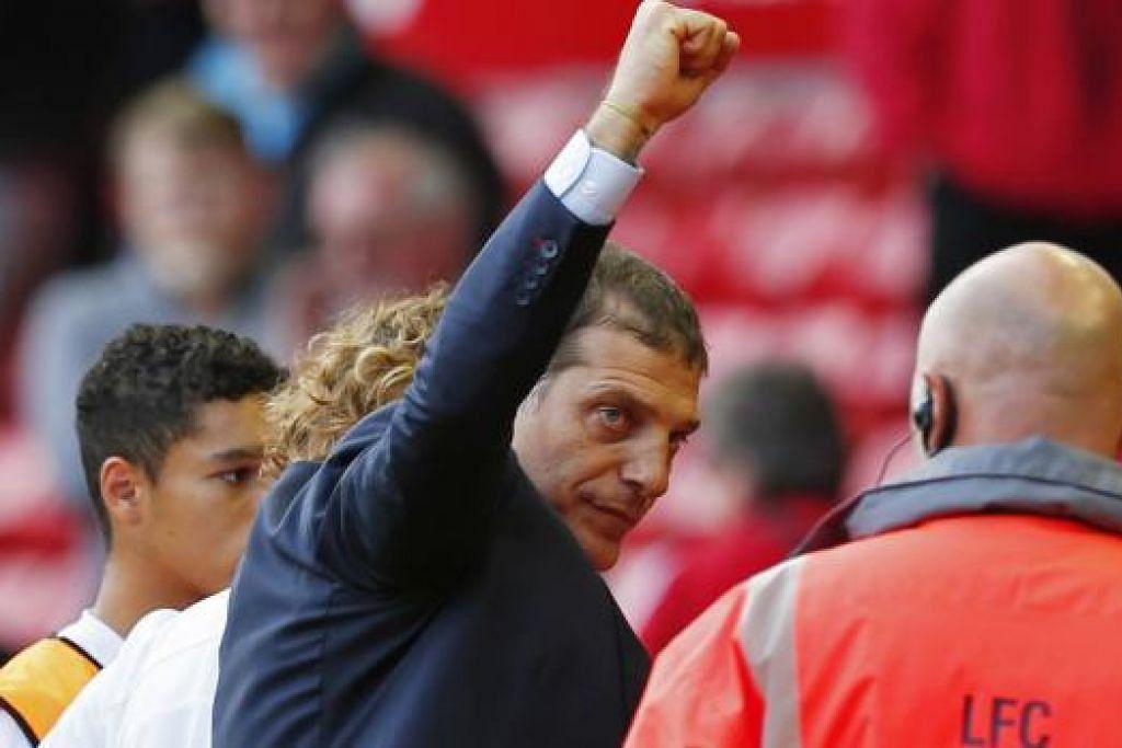 KEMENANGAN HEBAT: West Ham pimpinan Slaven Bilic mengejutkan Liverpool kelmarin, menyusuli kejayaan ke atas Arsenal pada hari pembukaan liga musim baru ini pada 9 Ogos lalu. - Foto REUTERS