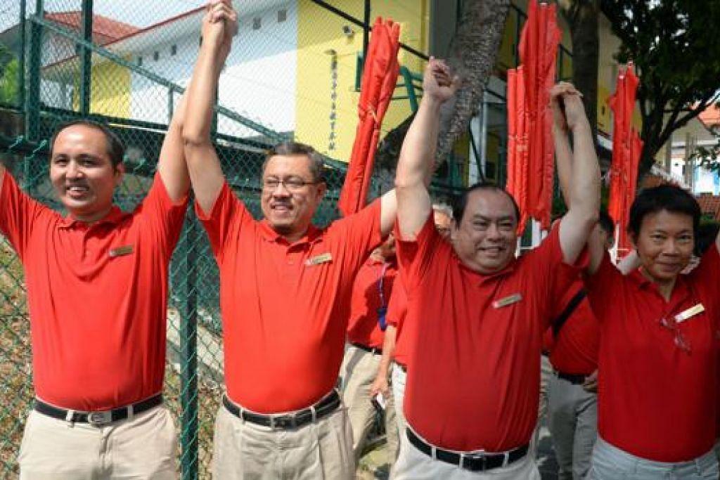 PASUKAN SDP MARSILING- YEW TEE: (Dari kiri) Encik Bryan Lim, Encik Damanhuri Abas, Encik John Tan dan Cik Wong Souk Yee. - Foto THE STRAITS TIMES