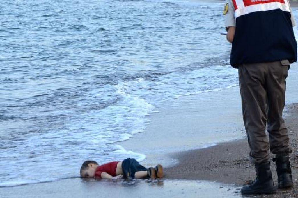 Mayat Aylan ditemui terdampar di pantai di Bodrum. Gambar AFP