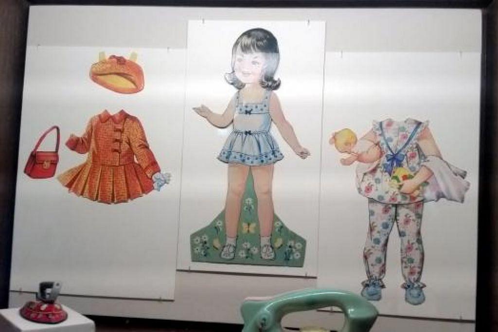 ANAK PATUNG KERTAS: Biarpun hanya patung kertas, kanak-kanak yang membesar dalam era 1970-an dan 1980-an seronok bermain dengan anak patung yang boleh dipelbagaikan fesyen baju, beg tangan dan topinya. – Foto-foto HANIM MOHD SALEH