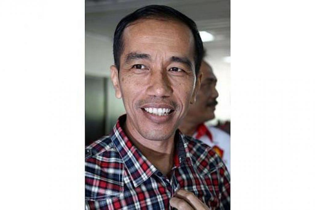 PRESIDEN JOKOWI: Pengisytiharan akan bolehkan pemerintah pusat ambil langkah segera menangani masalah jerebu yang kian memburuk, terutama di Sumatera dan Kalimantan. – Foto fail.