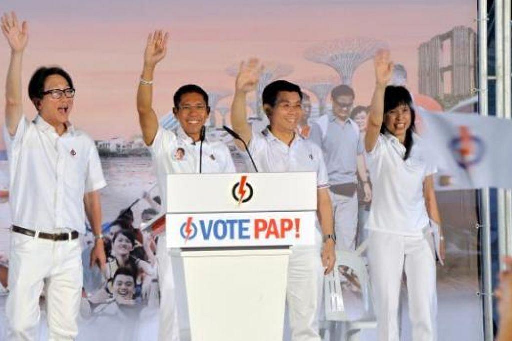PASUKAN PAP GRC EAST COAST: (Dari kiri) Encik Lim Swee Say, Dr Maliki Osman, Encik Lee Yi Shyan dan Cik Jessica Tan di rapat PAP di Stadium Bedok minggu lalu. - Foto M.O.SALLEH