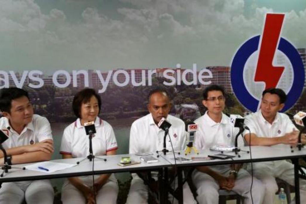 KEMPEN MEMUASKAN: Encik Shanmugam (tengah) bersama calon PAP di GRC Nee Soon (dari kiri), Encik Henry Kwek, Cik Lee Bee Wah, Profesor Madya Muhammad Faishal Ibrahim dan Encik Louis Ng, sewaktu menggulung kempen mereka semalam. - Foto AZAHAR MOHD