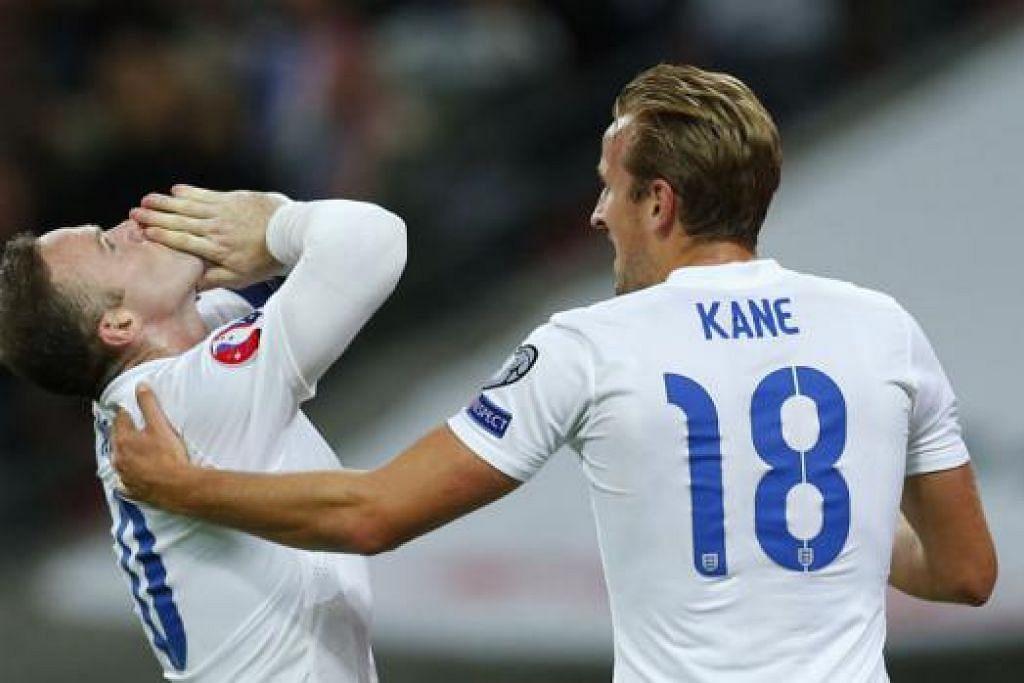 DETIK PENUH EMOSI: Wayne Rooney (kiri) begitu emosi semasa meraikan golnya dengan rakan penyerang, Harry Kane, yang turut menyumbangkan gol pembukaan England. Gol terbaru Rooney ini meletakkannya sebagai penjaring terbanyak dalam sejarah bola sepak England. - Foto REUTERS