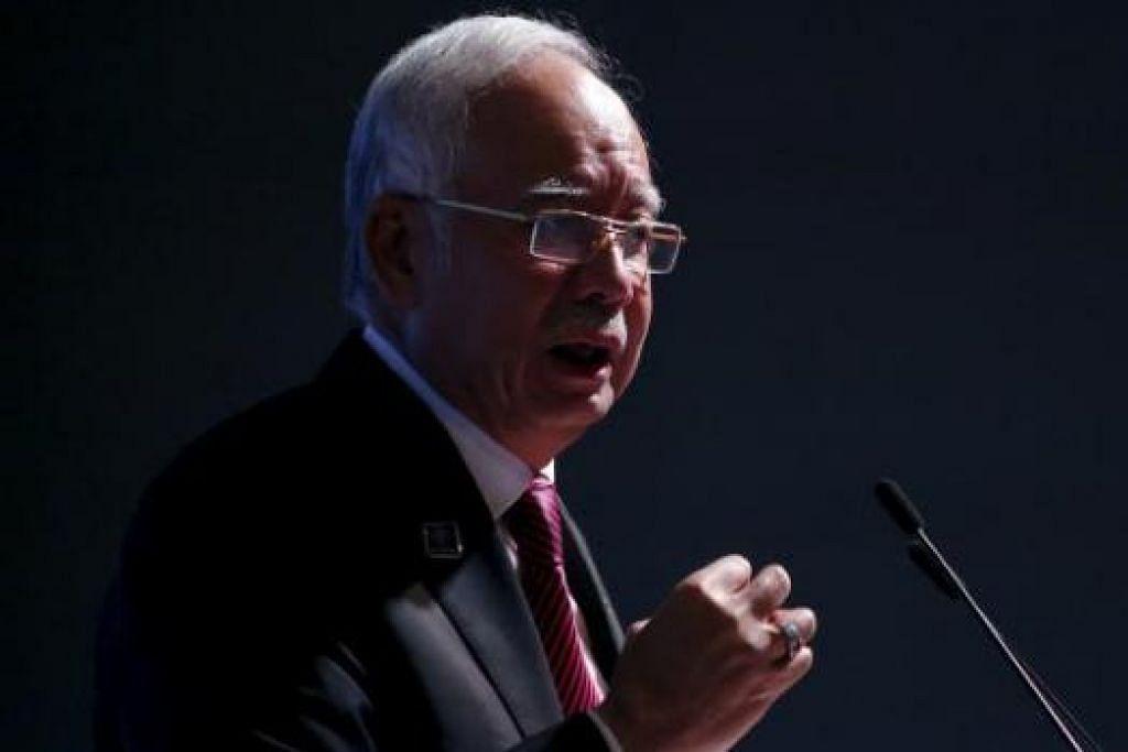 DISIASAT POLIS HONGKONG: Laporan telah dibuat menyatakan kemasukan lebih AS$250 juta ($353 juta) telah dibuat ke dalam akaun bank Credit Suisse di Hongkong menerusi empat syarikat yang dikaitkan dengan Datuk Najib. - Foto AFP
