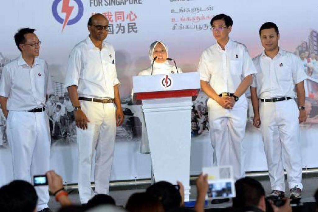 ANGGOTA PARLIMEN BARU: Cik Rahayu bersama pasukan PAP bagi GRC Jurong yang terdiri daripada (dari kiri) Encik Tan Wu Meng, Encik Tharman Shanmugaratnam, Encik Ang Wei Neng dan Encik Desmond Lee. - Foto M.O. SALLEH