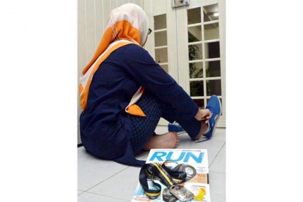 LARI UNTUK MENGUMPUL DANA: Ashiqin (bukan nama sebenar) ghairah ingin berlari dalam acara Larian Projek Reben Kuning tahun ini, kali kedua beliau menyertai acara tersebut. Beliau akan berlari bersama keluarganya. - Foto KHALID BABA