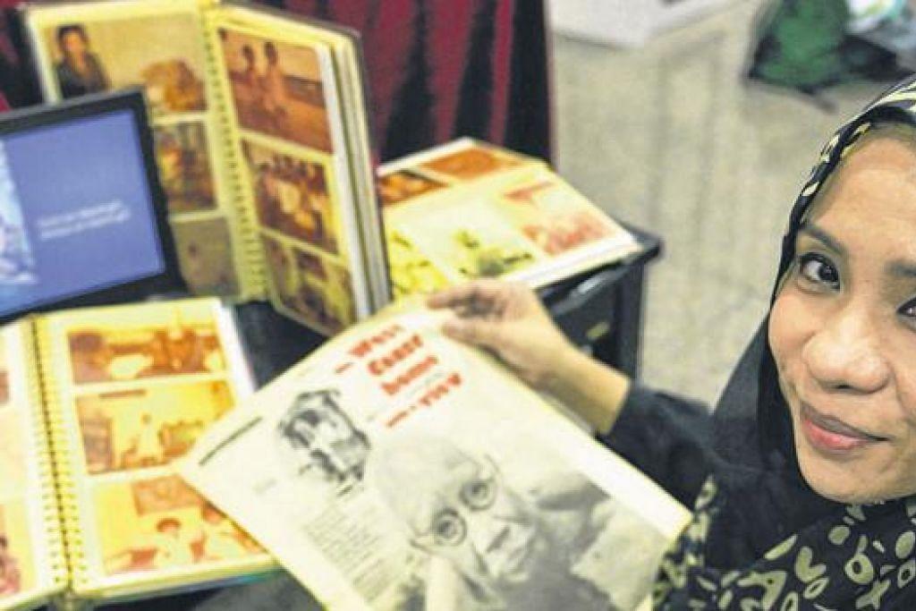 GIGIH MENJEJAK SEJARAH KELUARGA: Cik Asnida kian berminat mengkaji salasilah dan kisah nostalgia keluarganya selepas terlibat dalam pelbagai aktiviti budaya. - Foto KHALID BABA