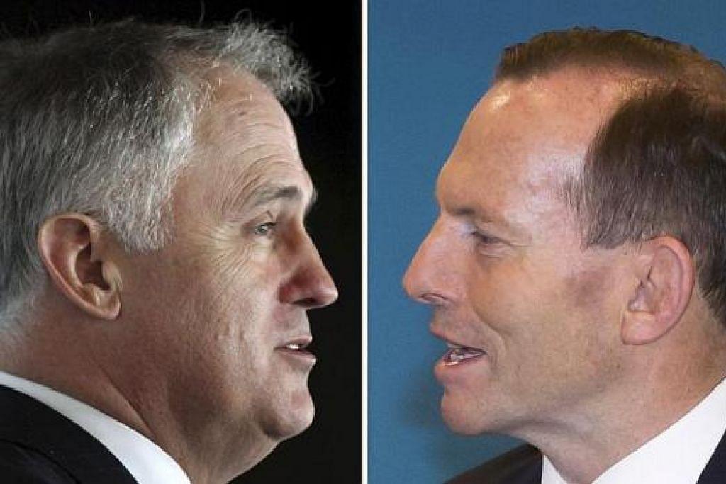 BERALIH PUCUK PIMPINAN: Encik Malcolm Turnbull (kiri) mengatasi Encik Tony Abbott untuk jadi Perdana Menteri Australia. – Foto REUTERS