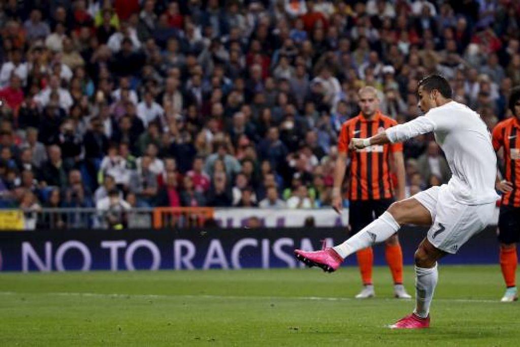 Cristiano Ronaldo menjaringkan salah satu daripada tiga golnya bagi Real Madrid, yang menundukkan Shakhtar Donetsk 4-0. Gambar REUTERS