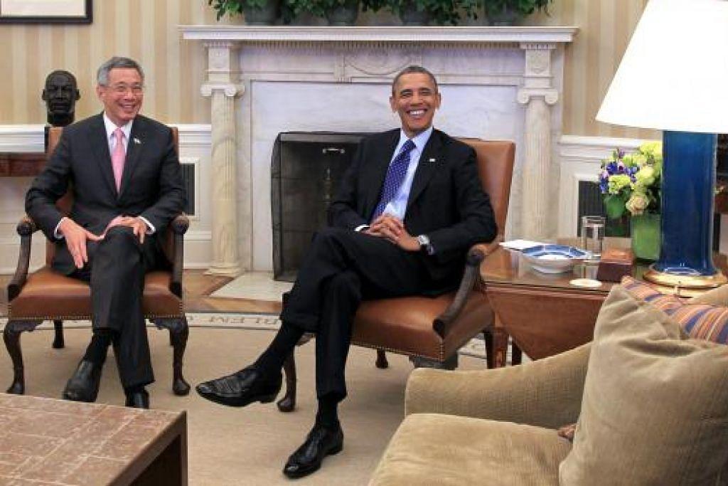 Perdana Menteri Lee Hsien Loong bersama Encik Barack Obama semasa satu pertemuan di Rumah Putih. Gambar fail THE STRAITS TIMES