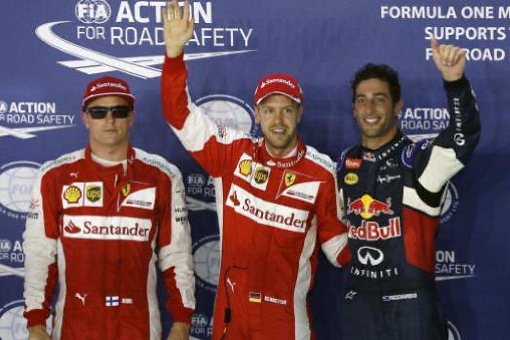 TIGA TERPANTAS: Bintang Ferrari, Sebastian Vettel (tengah) mencatatkan masa terpantas di sesi kelayakan dan akan memulakan perlumbaan malam ini (20 September) di petak pertama. Pemandu Red Bull, Daniel Ricciardo (kanan), di petak kedua manakala seorang lagi pemandu Ferrari, Kimi Raikkonen, di petak ketiga.