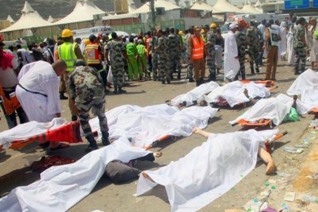 TRAGEDI MALANG: Keadaan menjadi tidak menentu apabila ratusan terkorban dan ramai jemaah lain cedera (gambar) dalam rempuhan di Tanah Suci semalam. - Foto Twitter, AFP