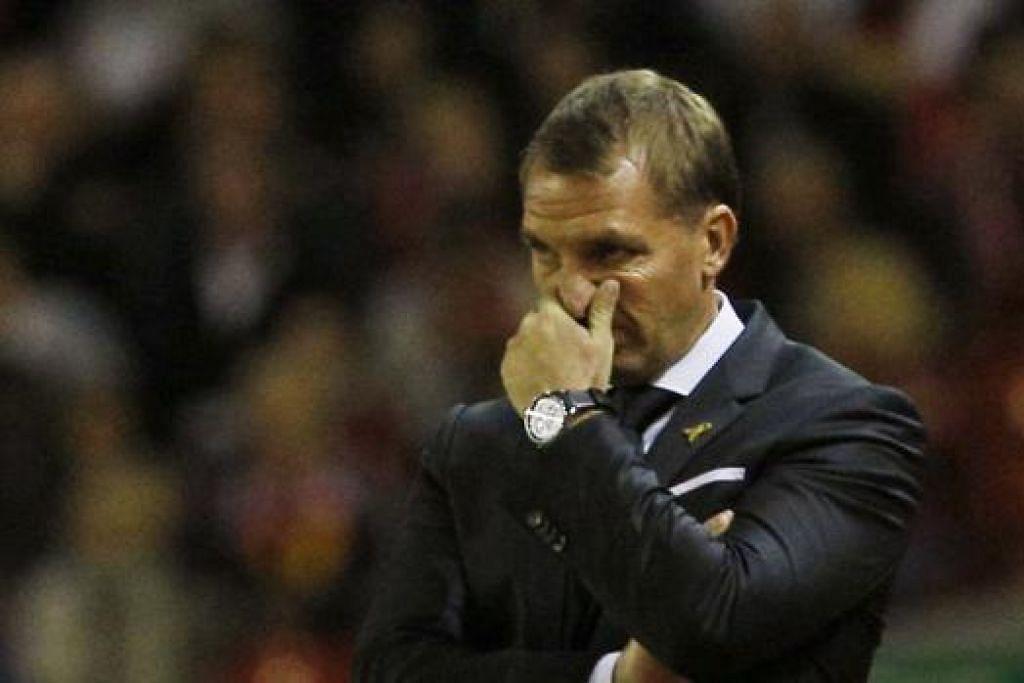 KIAN TERTEKAN: Pengurus Liverpool, Brendan Rodgers, menghadapi kedudukannya tergugat selepas pasukannya terkial-kial sejak permulaan musim baru ini. - Foto REUTERS