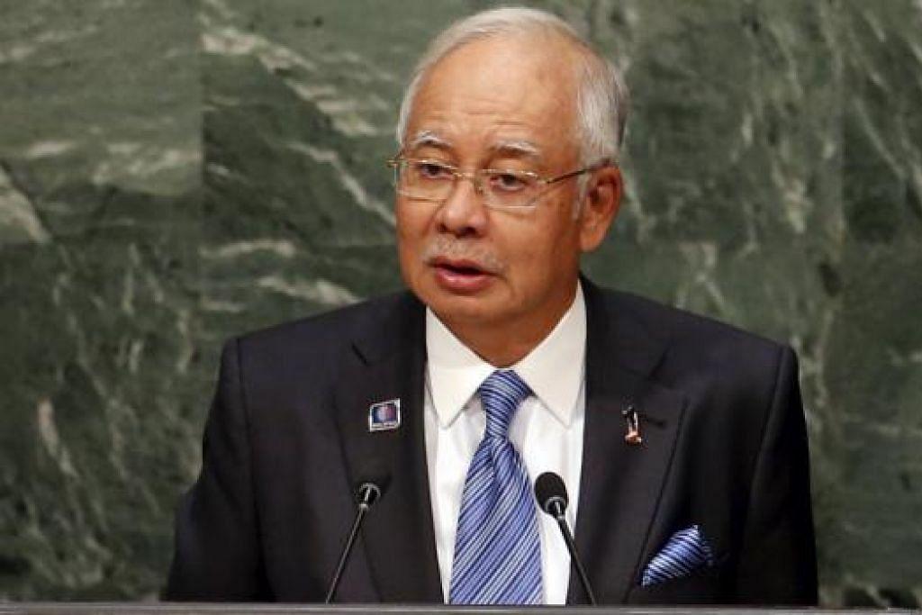 DATUK SERI NAJIB: Malaysia telah dapat mengurangkan kadar kemiskinan dan menghapuskan kemiskinan tegar. - Foto REUTERS