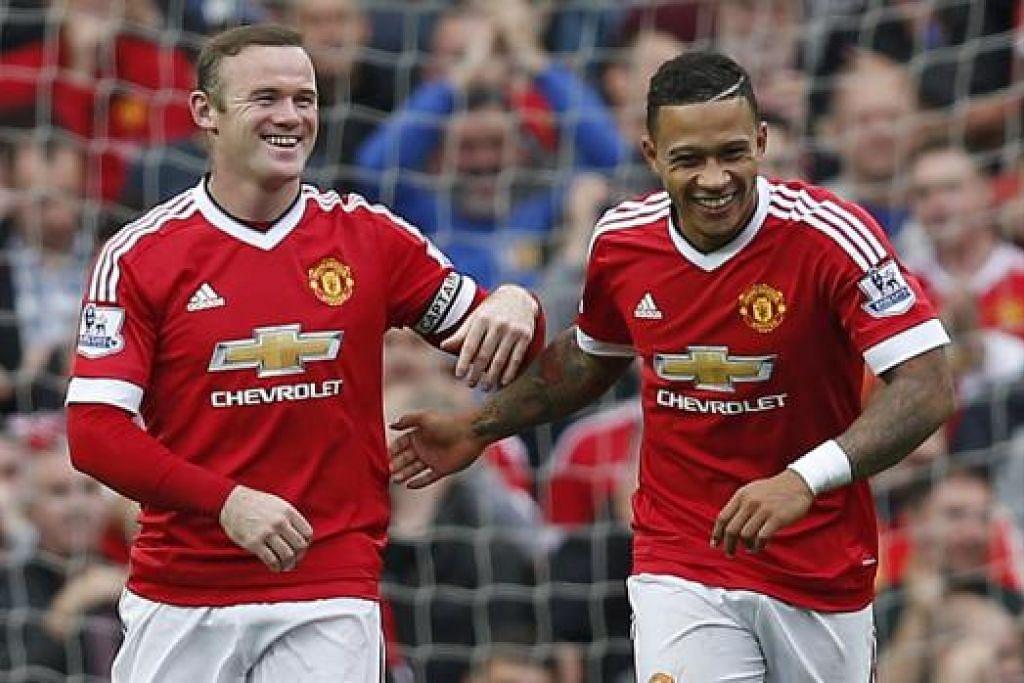 WAJAH-WAJAH CERIA: Kapten Manchester United, Wayne Rooney (kiri), yang kelihatan bersama Memphis Depay, serta bakat muda, Anthony Martial, diharapkan terus menyerlah bagi membantu perjuangan pasukan itu pula di Eropah. - Foto REUTERS