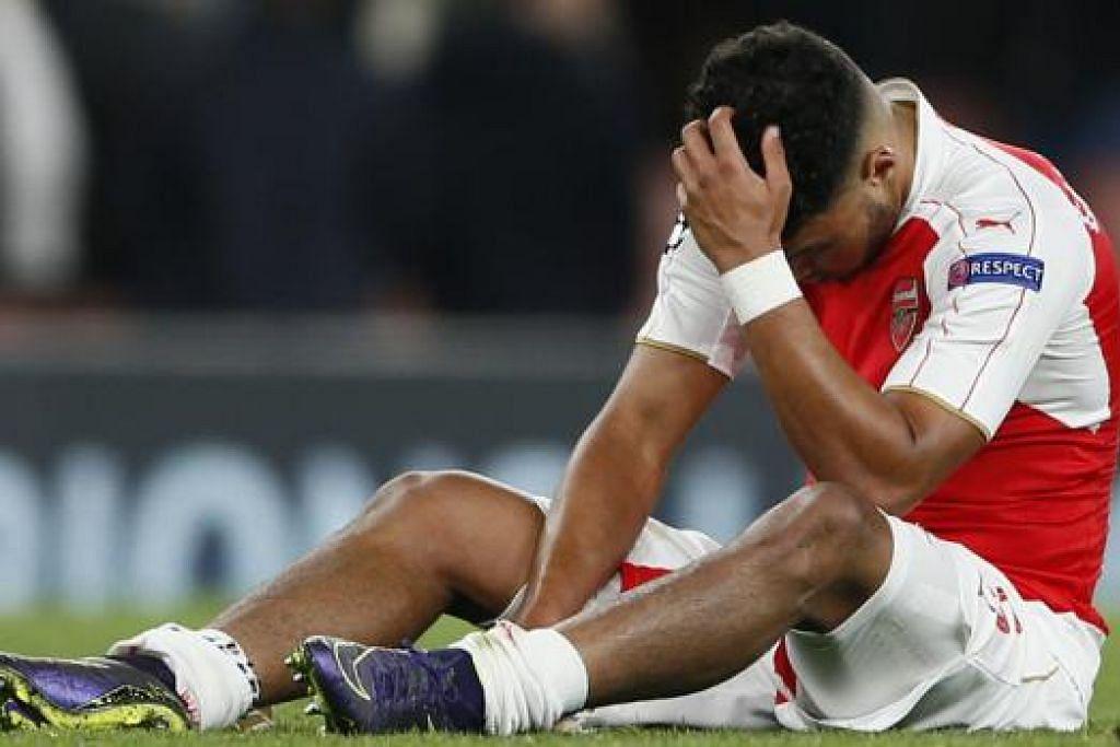 WAJAH KESEDIHAN: Tunggak midfield Arsenal, Alex Oxlade Chamberlain, begitu kecewa sekali dengan kekalahan terbaru yang menimpa pasukannya. - Foto REUTERS