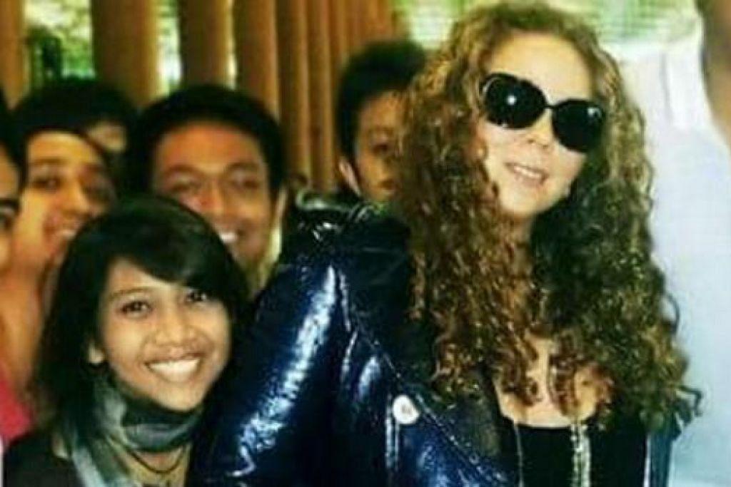 BINTANG INSPIRASI: Diva pop balada, Mariah Carey (kanan) dikagumi Cik Rohaishah (kiri) kerana lagu-lagu perkasa semangat seperti 'Hero'.
