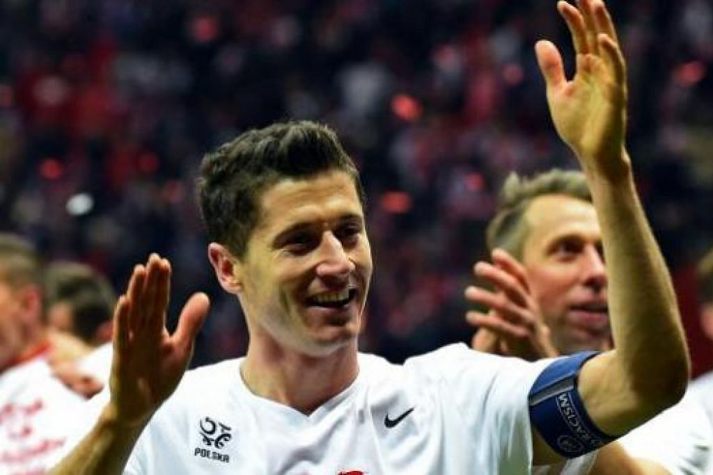 RAIKAN KEMENANGAN: Pemain Jerman meraikan kejayaan menempah tempat ke Euro 2016 manakala Robert Lewandowski (gambar) muncul wira kejayaan negaranya, Poland, menjamin tempat ke Perancis tahun depan. - Foto REUTERS, AFP