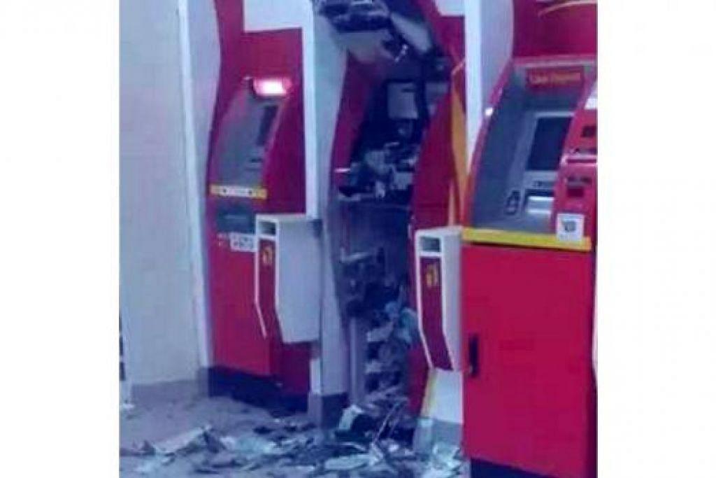 KESAN LETUPAN: Keadaan ATM selepas letupan. - Foto TH`E STAR