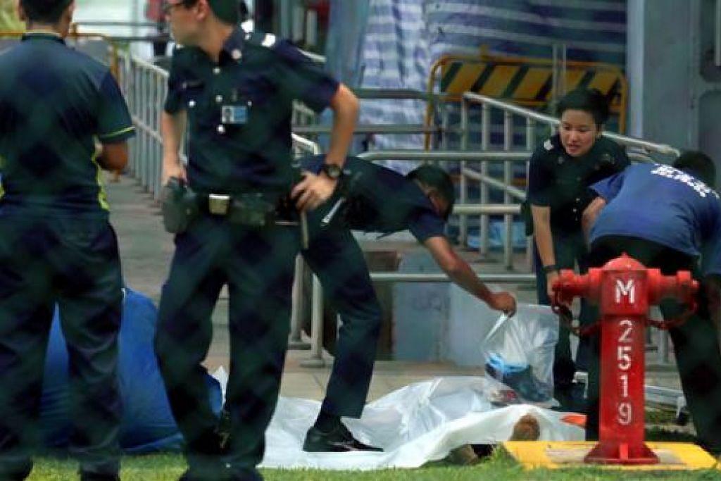 KEMATIAN MISTERI: Polis sedang menyiasat kes kematian luar biasa seorang lelaki yang dijumpai terapung di Kolam Air Lower Seletar. - Foto SHIN MIN
