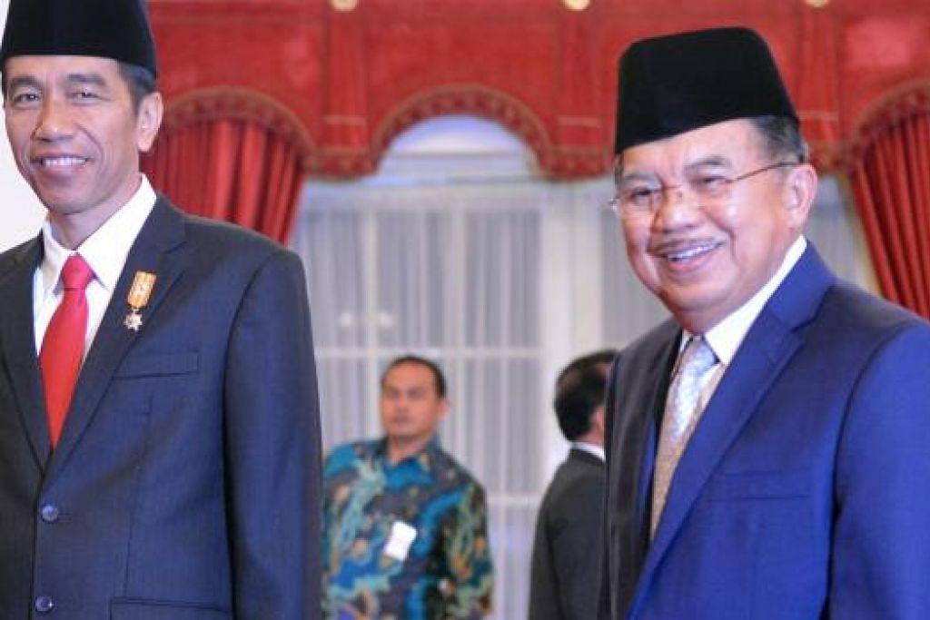 SETAHUN MEMIMPIN: Pasangan 'Jokowi-JK' berjaya meningkatkan prestasi perkhidmatan awam dan menarik pelaburan ke Indonesia. - Foto THE JAKARTA POST