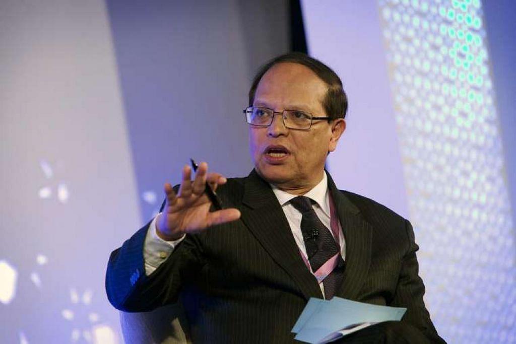 Encik Atiur Rahman di sebuah persidangan di New Delhi, India pada 12 March 2016.