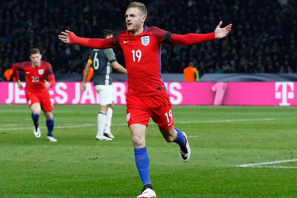 TERUS MENYENGAT: Penyerang Leicester, Jamie Vardy, meraikan gol sulungnya bagi England semasa menentang Jerman di Stadium Olimpik Berlin dinihari semalam. - Foto REUTERS