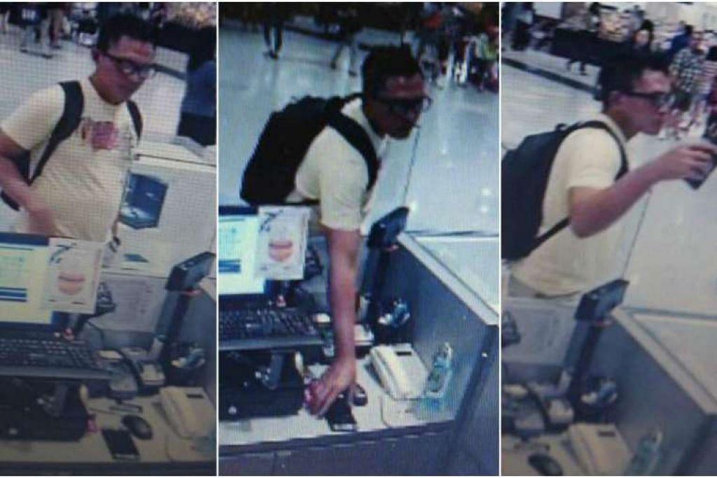 Gambar skrin rakaman CCTV menunjukkan seorang lelaki mencuri telefon dari kaunter sebuah kedai di VivoCity.