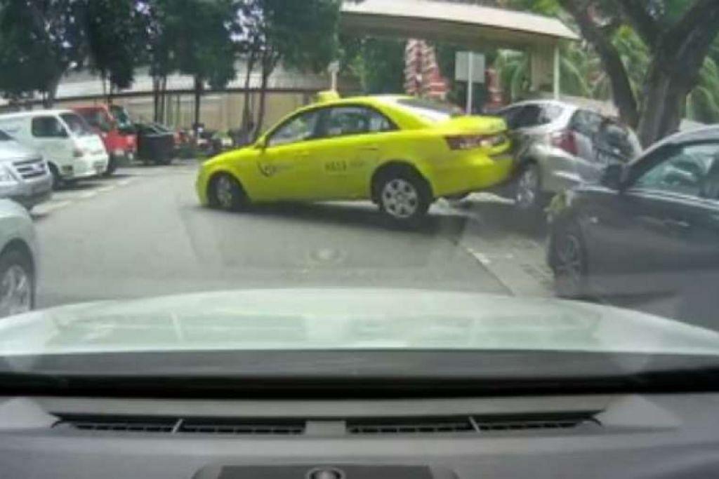Teksi kuning City Cab ini berundur pada kelajuan agak tinggi dan melanggar sebuah kereta yang diletak di sebuah tempat letak kereta di Redhill.
