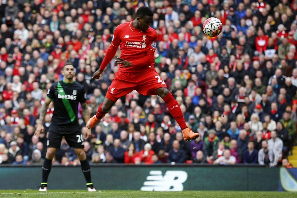 Divock Origi manjaringkan gol ketiga Liverpool, yang mengalahkan Stoke City 4-1 di Anfield pada Ahad (10 Apr).