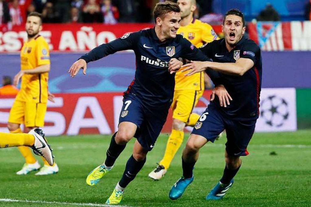 Pemain Atletico Madrid, Antoine Griezmann (tengah), merai gol keduanya yang dijaringkan melalui sepakan penalti dalam kemenangan 2-0 ke atas Barcelona dalam perlawanan suku akhir kedua pada Rabu (13 Apr).